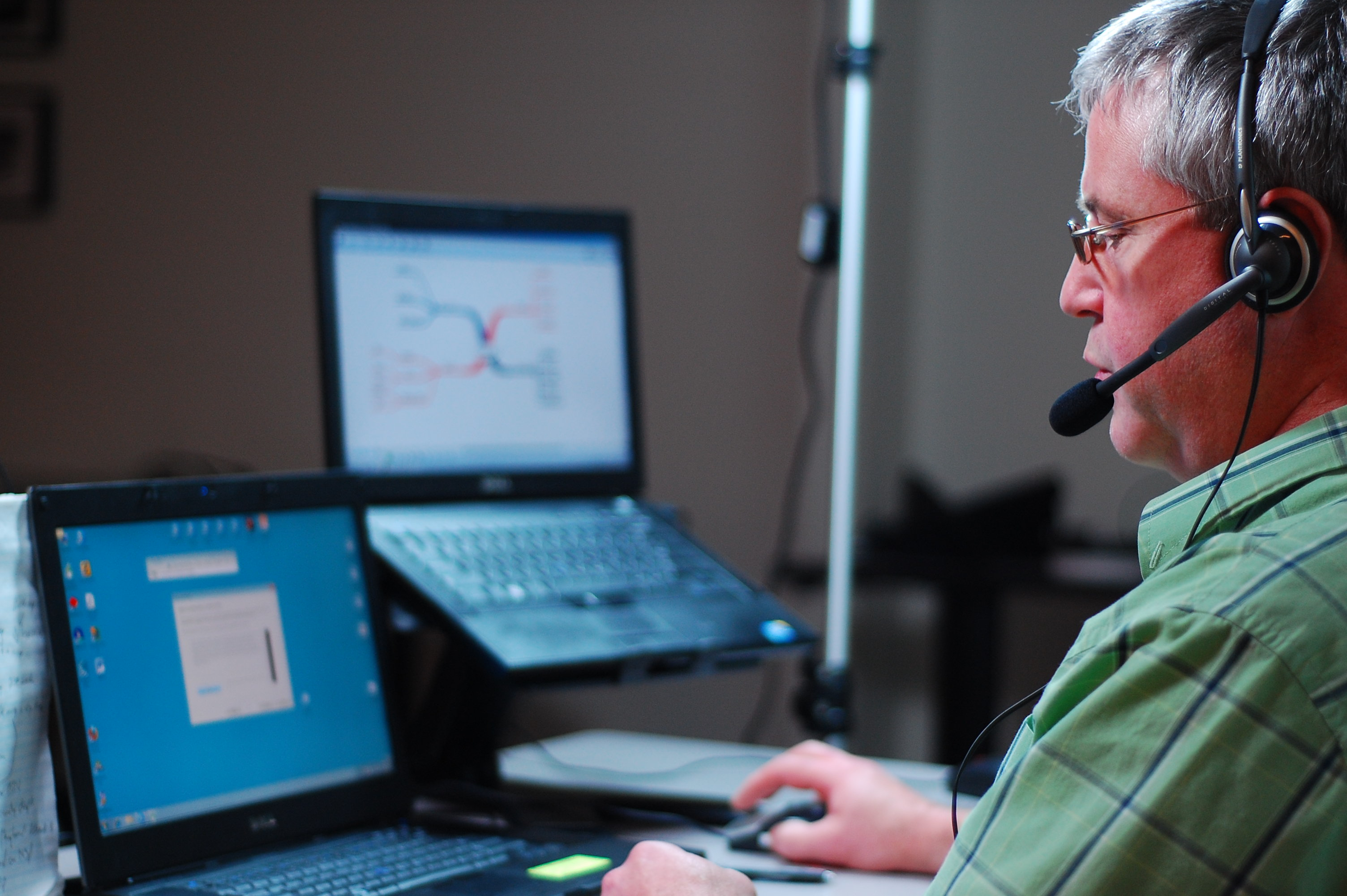 Photo of an ATBC consultant demonstrating assistive technology